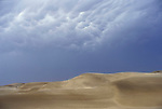 Storm  clouds in the Namib Naukluft desert.  Access is restricted due to Diamond mining activity by DeBeers.