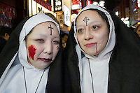 Two Japanese women, dressed as nuns during the Halloween celebrations in Shibuya, Tokyo, Japan. Saturday October 29th 2016 Halloween celebration in Japan have grown massively in the last few years. To ensure the safety of the crowds in Shibuya this year, the police closed several roads leading to the famous Hachiko Square, allowing costumed revellers to spread over a larger area.