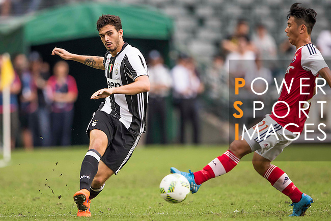 Juventus' player Giulio Parodi contests the ball against South China's player Law Hiu Chung during the South China vs Juventus match of the AET International Challenge Cup on 30 July 2016 at Hong Kong Stadium, in Hong Kong, China.  Photo by Marcio Machado / Power Sport Images
