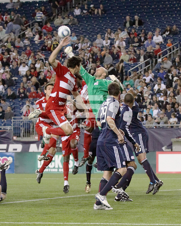 New England Revolution goalkeeper Preston Burpo (24) punches the ball clear during a corner kick.  The New England Revolution drew FC Dallas 1-1, at Gillette Stadium on May 1, 2010