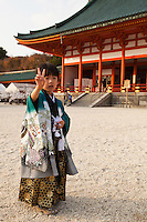 "Little Japanese boy dressed in kimono for ""Shichi-Go-San"" at Heian Shrine in Kyoto.  Shichi go san is literally 7-5-3 - a traditional rite of passage and festival day in Japan for children the age of seven, five or three held annually on November 15.  As Shichi-Go-San is not a national holiday, it is normally observed on the nearest weekend.  Children are still dressed in kimono, many for the first time, for visits to shrines though western-style formal wear is also worn by some children."