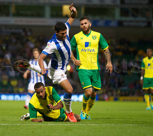 06.08.13 Norwich, England.  Carlos Vela of Sociedad goes down under the challenge during the Pre Season Friendly between Norwich and Real Sociedad from Carrow Road.