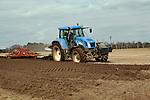 New Holland tractor disc harrowing field, Sutton, Suffolk, England