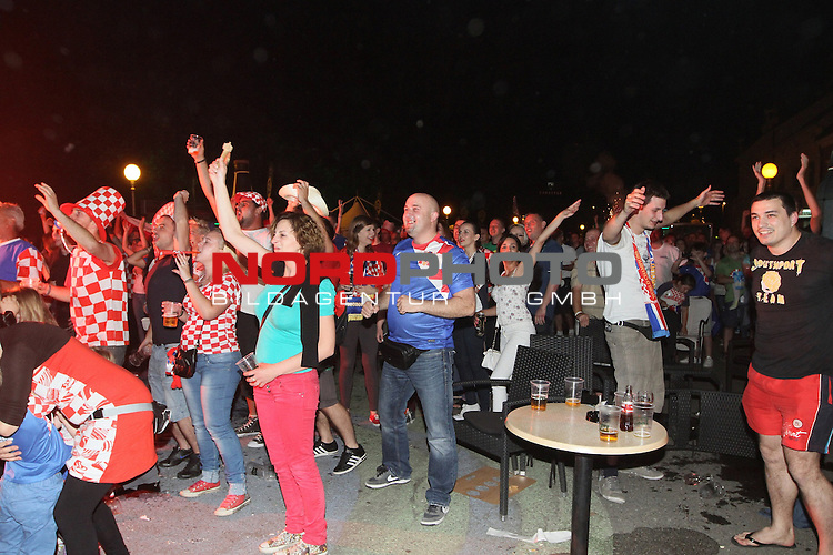 12.06.2014. Croatia, Koprivnica - Fans in bars and on the  squares follow the game opening match of 2014 FIFA World Cup between Brazil and Croatia. The celebration after the goal<br /> Photo: Marijan Susenj/PIXSELL