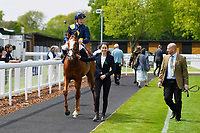 Winner of The Simon & Nerys Dutfield Memorial Novice Stakes  Sybolize ridden by David Probert and trained by Andrew Balding  is led into the Winner's enclosure during Afternoon Racing at Salisbury Racecourse on 16th May 2019
