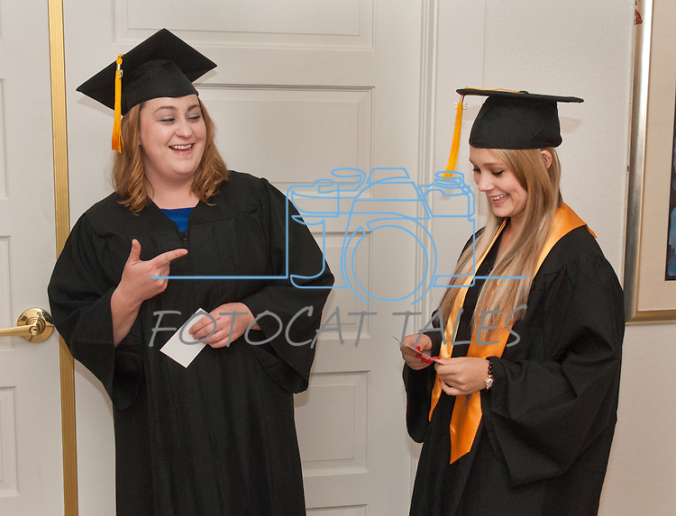 Stephanie Bishop, left and Kim Moore relax before the WNC graduation at the Western Nevada College commencement in Fallon, Nev., on Tuesday, May 20, 2014. <br /> Photo by Kim Lamb