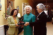First lady Barbara Bush, center, receives a TeleCaption decoding device from John E.D. Ball, President of the National Captioning Institute (NCI), right, and actress Marlee Matlin, Chairperson of Friends of NCI, left, at the White House in Washington, DC on June 19, 1990.  The devices allow hearing impaired and other viewers to see captions on their televisions. <br /> Mandatory Credit: Carol T. Powers / White House via CNP