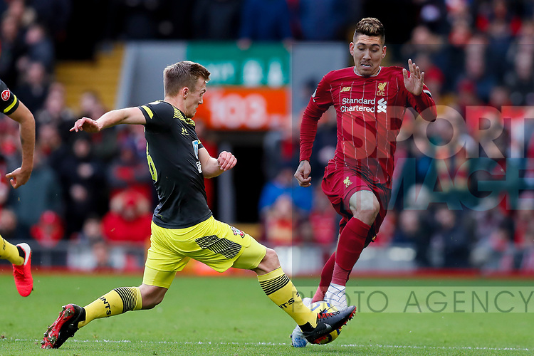 James Ward-Prowse of Southampton tackles Roberto Firmino of Liverpool during the Premier League match at Anfield, Liverpool. Picture date: 1st February 2020. Picture credit should read: James Wilson/Sportimage