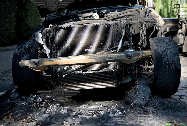 A burnt out car in Berlin. The cause of the fire was not immediately known, but investigating police officers said an arson attack is likely.