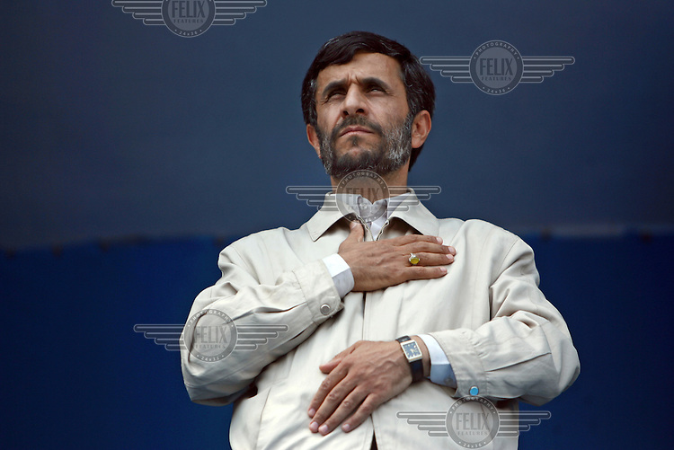 President Mahmoud Ahmadinejad presses his palm to his heart whilst he listens to the Iranian national anthem in the ethnically Turkish north-western Iranian town of Ardabil.