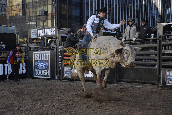 TYLER SMITH rides RUDOLPH.Ford Trucks Professional Bull Riders (PBR) Invasion of the Bulls at the corner of 33rd Street and 8th Avenue, New York, New York, USA..January 3rd, 2008.full length animal sport bucking gesture throwing cowboy.CAP/ADM/BL.©Bill Lyons/AdMedia/Capital Pictures. *** Local Caption ***