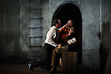 """London, UK. 09.03.2016. English Touring Opera presents """"Don Giovanni"""", by Wolfgang Amadeus Mozart, at the Hackney Empire.  Directed by Lloyd Wood, with set & costume design by Anna Fleischle and lighting design by Guy Hoare. Picture shows:  George von Bergen (Don Giovanni), Matthew Stiff (Leporello). Photograph © Jane Hobson."""