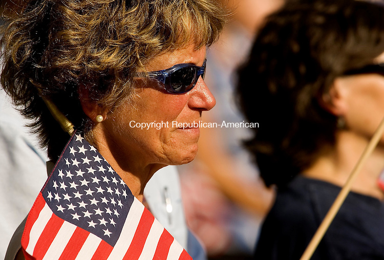 WASHINGTON, CT - 10 JULY 2005 -071005JS04--An unidentified woman fights back tears as the town of Washington remembered Maj. Stephen Reich during a service of prayer and thanksgiving Sunday at Washington Town Hall. Reich and 15 other service members were killed on June 28 when their MH47 Chinook helecopter was shot down in Afghanistan --Jim Shannon Photo-- George; Maj. Stephen Reich, Afghanistan  are CQ