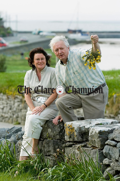 Pauline Burke, PRO and Jim Mc Carthy, chairman of Burren in Bloom celebration, collecting furze for the traditional placement on the doors of homes in Ballyvaughan, on May Eve, as part of the Burren in Bloom celebration. Photograph by John Kelly.