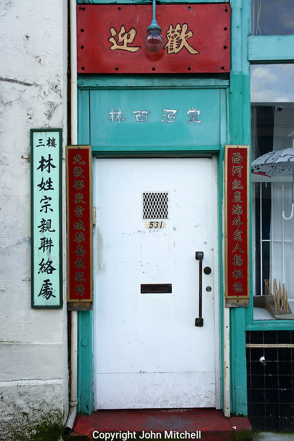 Door surrounded by Chinese characters in Chinatown, Vancouver, British Columbia, Canada.