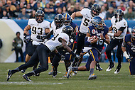 Philadelphia, PA - December 12, 2015:   Navy Midshipmen quarterback Keenan Reynolds (19) avoids the Army defender during the 116th game between Army vs Navy at Lincoln Financial Field in Philadelphia, PA. (Photo by Elliott Brown/Media Images International)