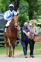 16th May 2020, Nordrhein-Westfalen, Duesseldorf, Germany;  Lancade with Jockey Adrie de Vries and Trainer Yasmin Almenraeder with protective masks