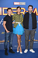 Tom Holland, Zendaya &amp; director Jon Watts at the 'Spider-Man: Homecoming' photocall at The Ham Yard Hotel, London, UK. <br /> 15 June  2017<br /> Picture: Steve Vas/Featureflash/SilverHub 0208 004 5359 sales@silverhubmedia.com
