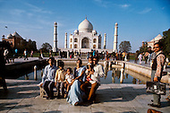 Agra, India, January 1975: Visitors in front of the Taj Mahal located in Agra, India. Taj Mahal is a white marble mausoleum built by Mughal emperor Shah Jahan in memory of his third wife, Mumtaz Mahal. Taj Mahal is the finest example of Mughal architecture, a style that combines elements from Persian, Turkish and Indian architectural styles and also considered as one of the seven wonders of the world. In 1983, the Taj Mahal became a UNESCO World Heritage Site.