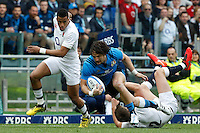 Rugby, Torneo delle Sei Nazioni: Italia vs Inghilterra. Roma, 14 febbraio 2016.<br /> Italy's Michele Campagnaro is challenged by England's Anthony Watson, left, and Owen Farrell, during the Six Nations rugby union international match between Italy and England at Rome's Olympic stadium, 14 February 2016.<br /> UPDATE IMAGES PRESS/Riccardo De Luca