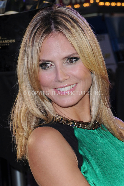 WWW.ACEPIXS.COM . . . . . .June 15, 2012...New York City....Heidi Klum attends 'Project Runway' 10th Anniversary Runway Event in Times Square on June 15,, 2012 in New York City ....Please byline: KRISTIN CALLAHAN - ACEPIXS.COM.. . . . . . ..Ace Pictures, Inc: ..tel: (212) 243 8787 or (646) 769 0430..e-mail: info@acepixs.com..web: http://www.acepixs.com .