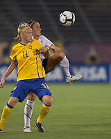 US defender Meghan Schnur (17) and Sweden forward Linnea Liljegard (11) battle for a ball. The US Women's national team beat Sweden, 3-0, at Rentschler Field on July 17, 2010.