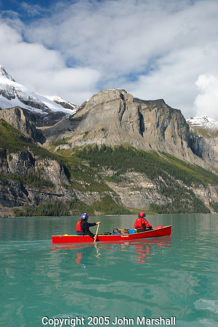 Trent and Linda Enzsol paddle a Wenonah Escape on Maligne Lake in Jasper National Park, Alberta, Canada
