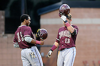 Designated hitter Bradley Jones (13) of the College of Charleston Cougars is congratulated by Morgan Phillips (15) after hitting a home run in the seventh inning of a game against the University of South Carolina Upstate Spartans on Tuesday, March 31, 2015, at Cleveland S. Harley Park in Spartanburg, South Carolina. Charleston won, 10-0. (Tom Priddy/Four Seam Images)