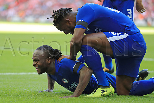 August 6th 2017, Wembley Stadium, London, England; FA Community Shield Final, Arsenal versus Chelsea; Michy Batshuayi of Chelsea celebrates with Victor Moses of Chelsea as he scores making it 0-1