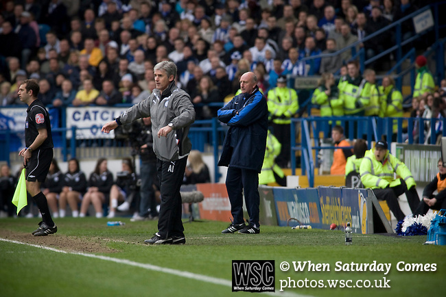 Crystal Palace manager Paul Hart (in background behind home manager Alan Irvine) watching his team at Hillsborough during the first half of the crucial last-day relegation match against Sheffield Wednesday. The match ended in a 2-2 draw which meant Wednesday were relegated to League 1. Crystal Palace remained in the Championship despite having been deducted 10 points for entering administration during the season.