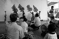 Artist are rehearsing one big shadow puppet performance below the stairs leading to the publics seats at the Preah Suramarith theatre. Phnom Penh, Cambodia-2007