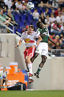 Teemu Tainio (2) of the New York Red Bulls and Diego Chara (21) of the Portland Timbers go up for a header during a Major League Soccer (MLS) match at Red Bull Arena in Harrison, NJ, on September 24, 2011.