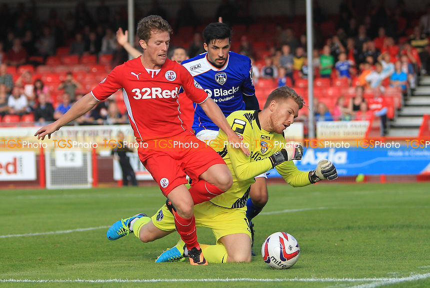 Billy Clarke of Crawley Town takes the ball round Mark Oxley of Oldham Athletic - Crawley Town vs Oldham Athletic - Sky Bet League One Football at the Broadfield Stadium Crawley, West Sussex - 28/09/13 - MANDATORY CREDIT: Simon Roe/TGSPHOTO - Self billing applies where appropriate - 0845 094 6026 - contact@tgsphoto.co.uk - NO UNPAID USE