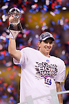 New York Giants Eli Manning (10) holds up the Vince Lombardi Trophy after beating the New England Patriots during the NFL Super Bowl XLVI football gameon Sunday, Feb. 5, 2012, in Indianapolis. The Giants won 21-17 (AP Photo/David Stluka)...