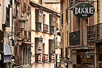 Winding street with shops and balconies, Segovia, Spain
