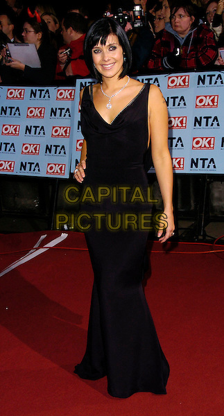 KYM RYDER.The National Television Awards 2006 held at the Royal Albert Hall, London, UK. - Arrivals.October 31st, 2006.Ref: CAN.full length dress black Kim Rider.www.capitalpictures.com.sales@capitalpictures.com.©Can Nguyen/Capital Pictures