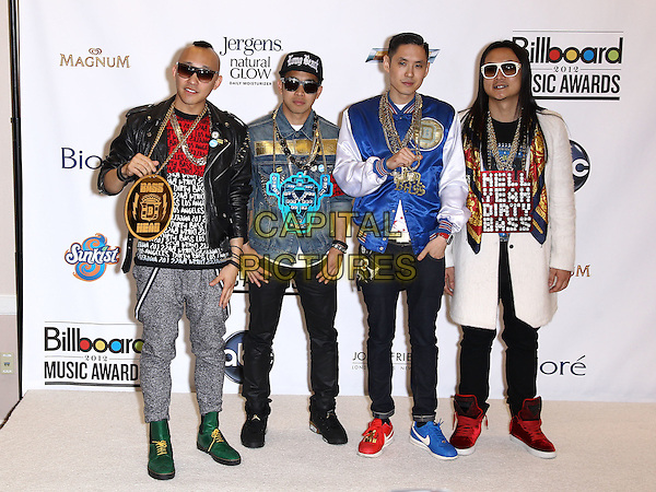 Far East Movement.2012 Billboard Music Awards Press Room at the MGM Grand Garden Arena Las Vegas, Las Vegas, Nevada, USA..May 20th, 2012.full length band group sunglasses shades jeans denim blue black white red grey gray jacket.CAP/ADM/MJT.© MJT/AdMedia/Capital Pictures.