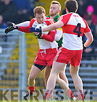 Barry John Keane Kerry in action against Aidan McAlynn Derry in round Two of the National Football league at Fitzgerald Stadium, Killarney on Sunday the 9th of February.