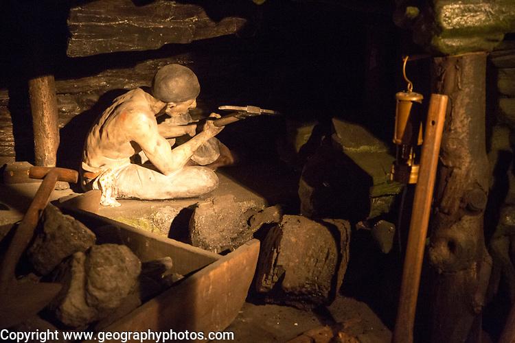 Coal mining display, miner at coalface using hand pick, Radstock museum, Somerset, England, UK