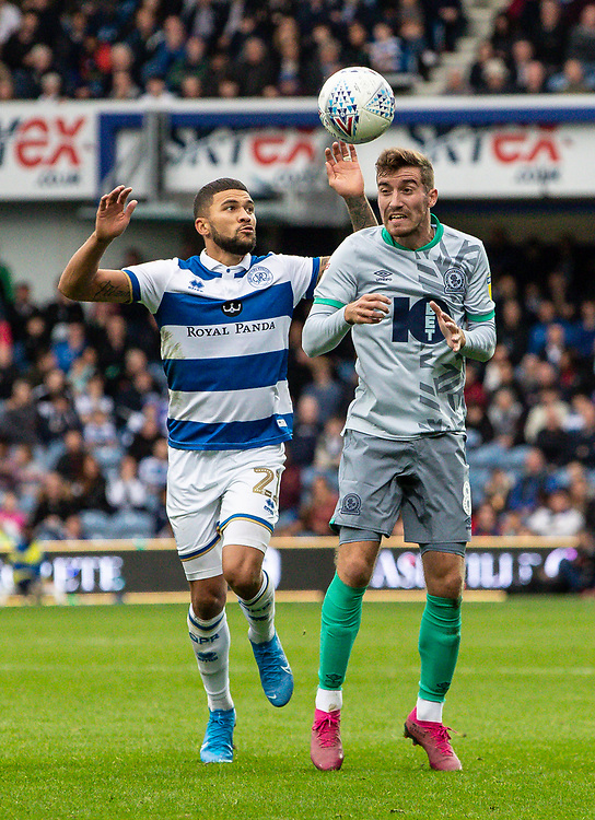 Blackburn Rovers' Joe Rothwell (right) heads under pressure from Queens Park Rangers' Nahki Wells <br /> <br /> Photographer Andrew Kearns/CameraSport<br /> <br /> The EFL Sky Bet Championship - Queens Park Rangers v Blackburn Rovers - Saturday 5th October 2019 - Loftus Road - London<br /> <br /> World Copyright © 2019 CameraSport. All rights reserved. 43 Linden Ave. Countesthorpe. Leicester. England. LE8 5PG - Tel: +44 (0) 116 277 4147 - admin@camerasport.com - www.camerasport.com