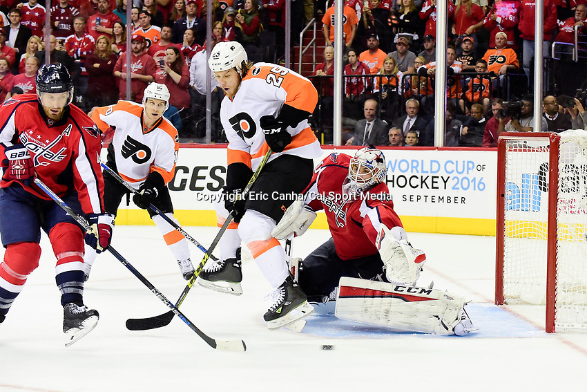 Thursday, April 14, 2016: Washington Capitals goalie Braden Holtby (70) reaches out to make a save during the National Hockey League Eastern Conference 1st round game 1 between the Philadelphia Flyers and the Washington Capitals held at the Verizon Center in Washington, DC. Washington defeats Philadelphia 2-0. Eric Canha/CSM