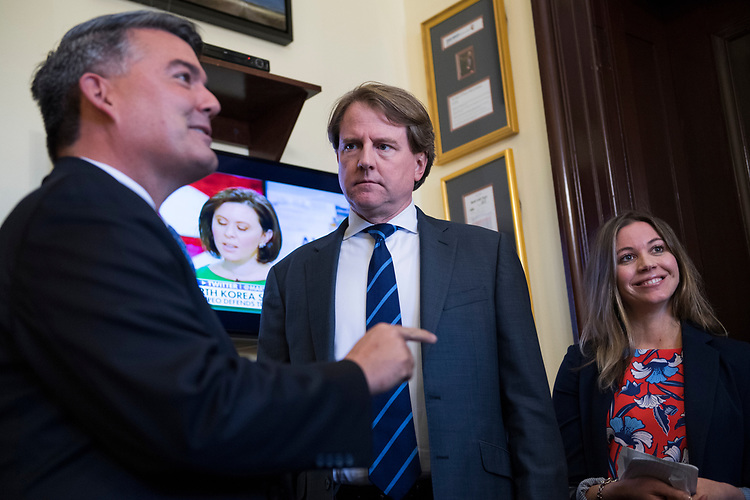 UNITED STATES - JULY 26: White House counsel Don McGahn, center, talks with Sen. Cory Gardner, R-Colo., left, before a meeting with Supreme Court nominee Brett Kavanaugh, off camera, in Russell Building on July 26, 2018. (Photo By Tom Williams/CQ Roll Call)