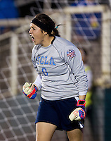 Katelyn Rowland (0) of UCLA celebrates saving a penalty kick during the Women's College Cup semifinals at WakeMed Soccer Park in Cary, NC. UCLA advance on penalty kicks after typing Virginia, 1-1 in regulation time.