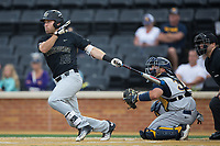 Logan Harvey (15) of the Wake Forest Demon Deacons lines an RBI single to left field in the top of the second inning against the West Virginia Mountaineers in Game Six of the Winston-Salem Regional in the 2017 College World Series at David F. Couch Ballpark on June 4, 2017 in Winston-Salem, North Carolina.  The Demon Deacons defeated the Mountaineers 12-8.  (Brian Westerholt/Four Seam Images)