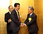 January 5, 2017, Tokyo, Japan - Japanese Prime Minister Shinzo Abe (C) is greeted by Japanese business group leaders Akio Mimura (L), Sadayuki Sakakibara (R) for a business leaders' New Year party at a Tokyo hotel on Tuesday, January 5, 2017.  (Photo by Yoshio Tsunoda/AFLO)