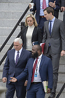 (L-R) US Secretary of Homeland Security Kirstjen Nielsen, Vice President Mike Pence and Ja'Ron Smith special assistant to the President of the United States exit the Eisenhower Executive Office Building on January 05, 2019 in Washington, DC. The U.S government is going into the third week of a partial shutdown with Republicans and Democrats at odds on agreeing with President Donald Trump's demands for more money to build a wall along the U.S.-Mexico border. Photo Credit: Tasos Katopodis/CNP/AdMedia