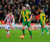9th February 2019, bet365 Stadium, Stoke-on-Trent, England; EFL Championship football, Stoke City versus West Bromwich Albion; Gareth Barry of West Bromwich Albion controls the ball in midfield
