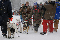 Handlers, including Barb Redington help Garry McKeller's team to the start line of the 2009 Junior Iditarod on Knik Lake on Saturday Februrary 28, 2009.