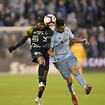 Romeesh Ivey  of Independiente (left) and Roger Espinoza of Sporting KC jump for a header. Sporting KC defeated Club Atletico Independiente 3-0 in a CONCACAF Champions League quarterfinal game at Children's Mercy Park on March 14, 2019.