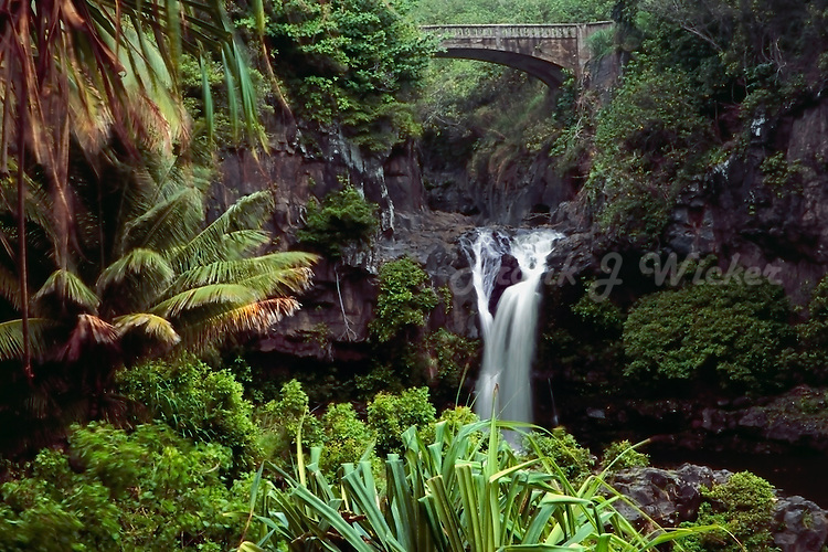 Beautiful tropical scene of a waterfall and bridge at the seven pools in Ohe'o Gulch in Haleakala National Park on Maui in Hawaii USA